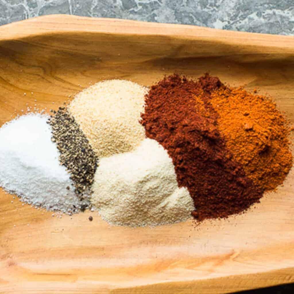 buffalo seasoning blend ingredients on a wooden board
