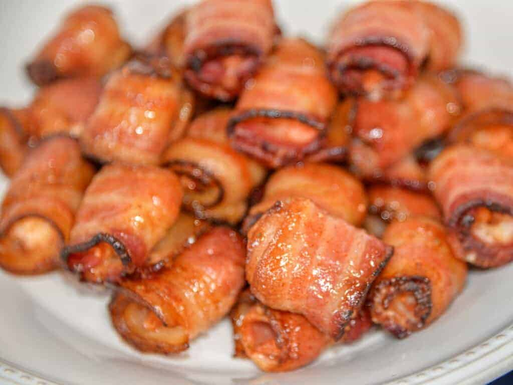 easy bacon wrapped shrimp on a white plate