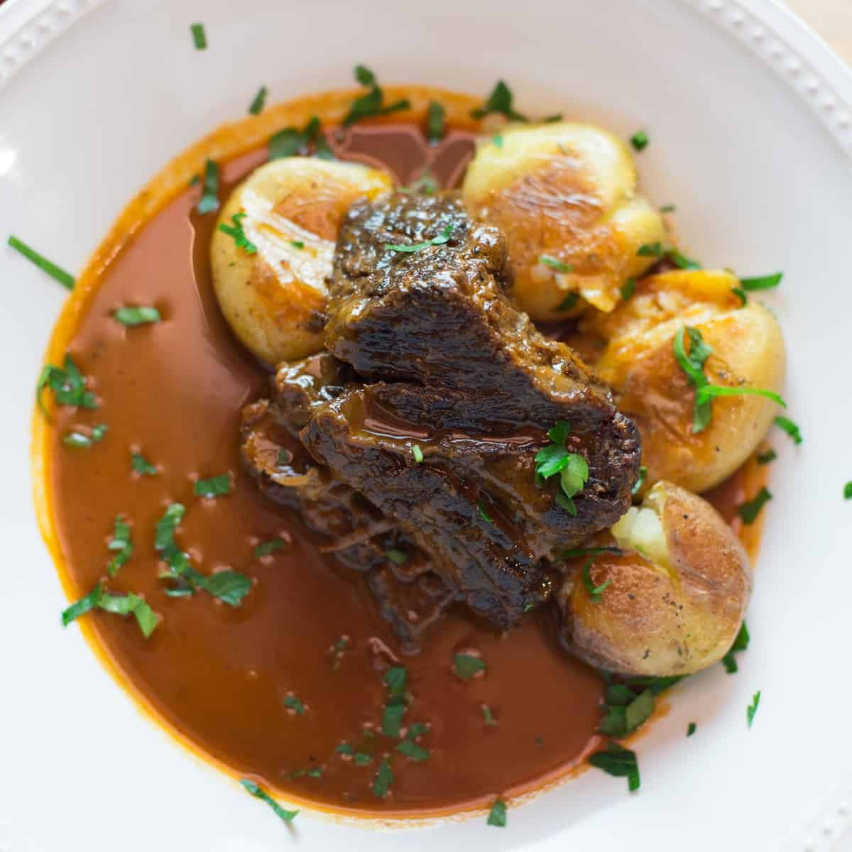 braised beef short ribs served with roasted potatoes