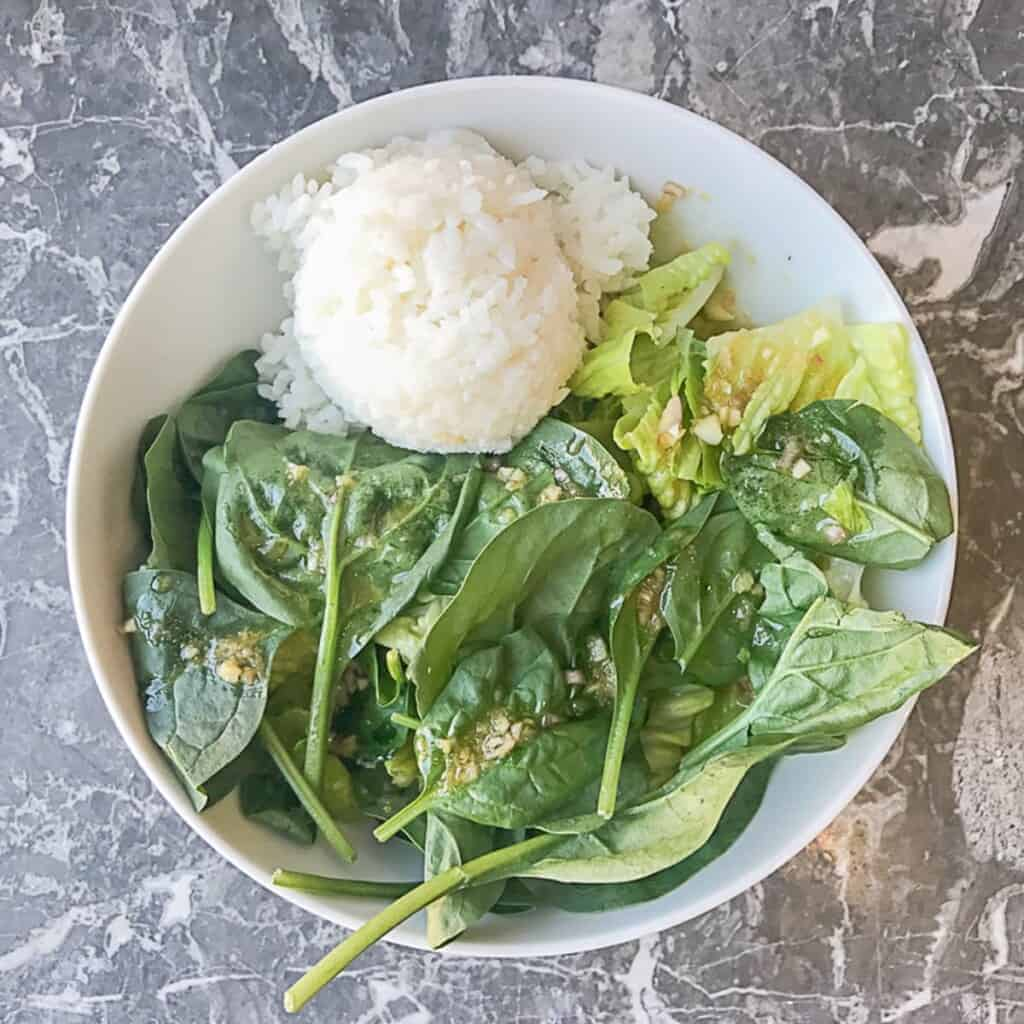 lettuce and spinach with sesame ginger dressing and a scoop of sushi rice
