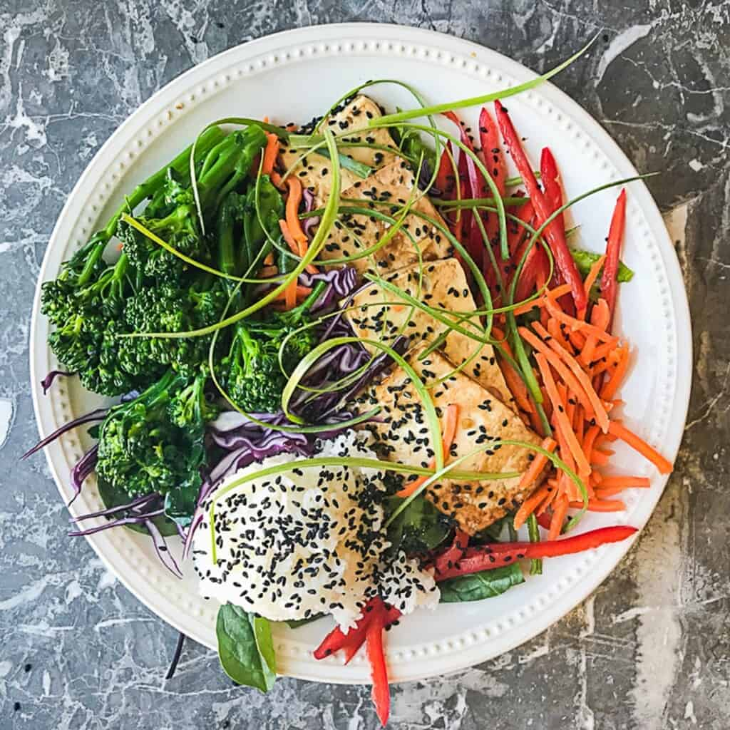 healthy vegan teriyaki bowl with extra firm tofu and lots of veggies