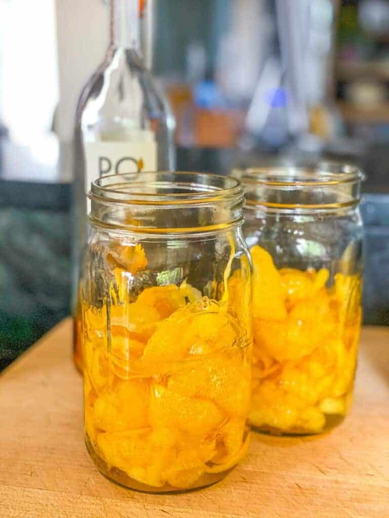 lemon peels in mason jars with alcohol, making limoncello
