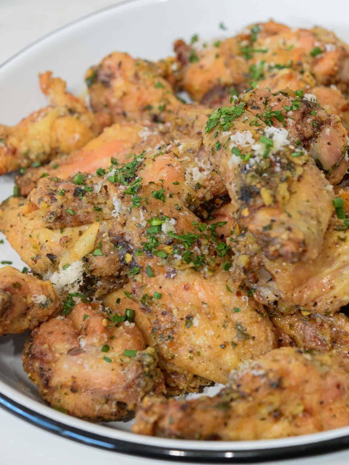 a huge plate of garlic parmesan wings