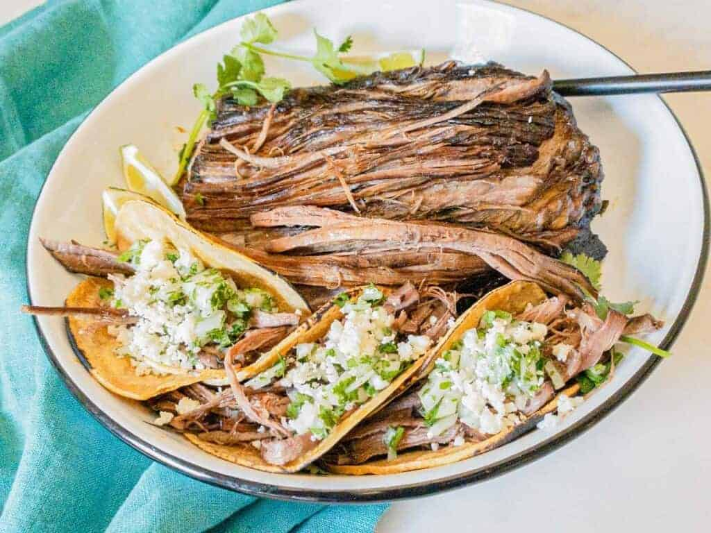 pulled beef tacos with cotija cheese and cilantro and onions