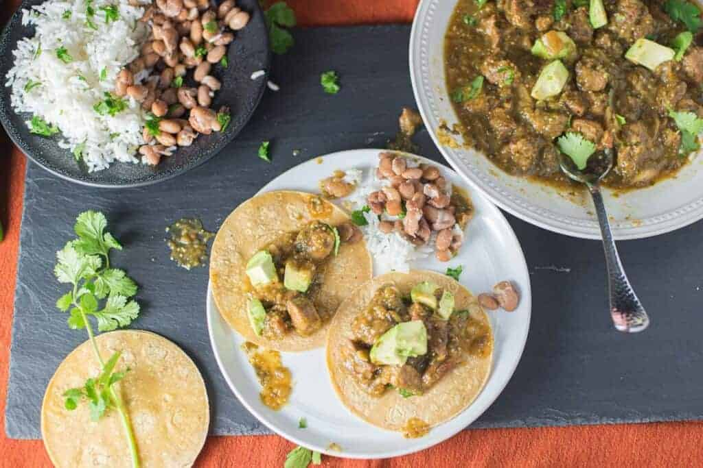 chili verde tacos served with rice and beans and or course corn tortillas