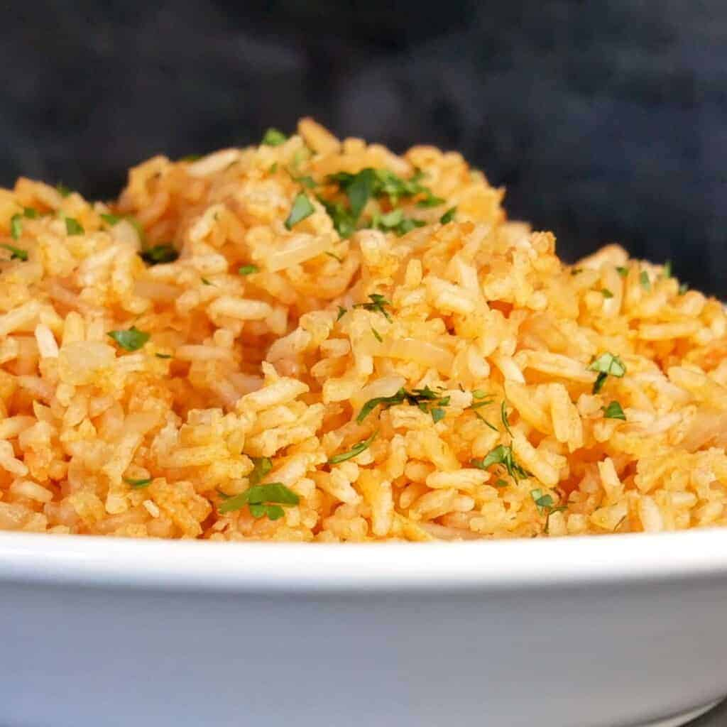 homemade restaurant style Mexican rice recipe sprinkles with fresh minced cilantro