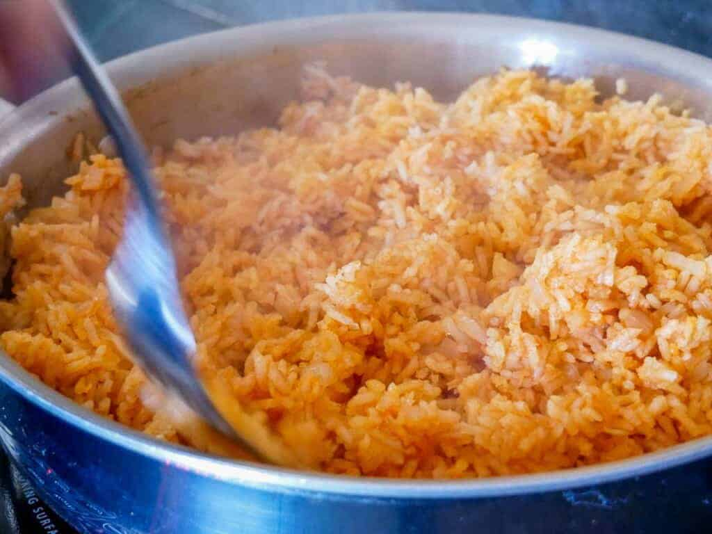 remove the lid and fluff the rice with a fork