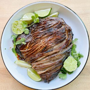 shredded beef taco recipe served with fresh limes