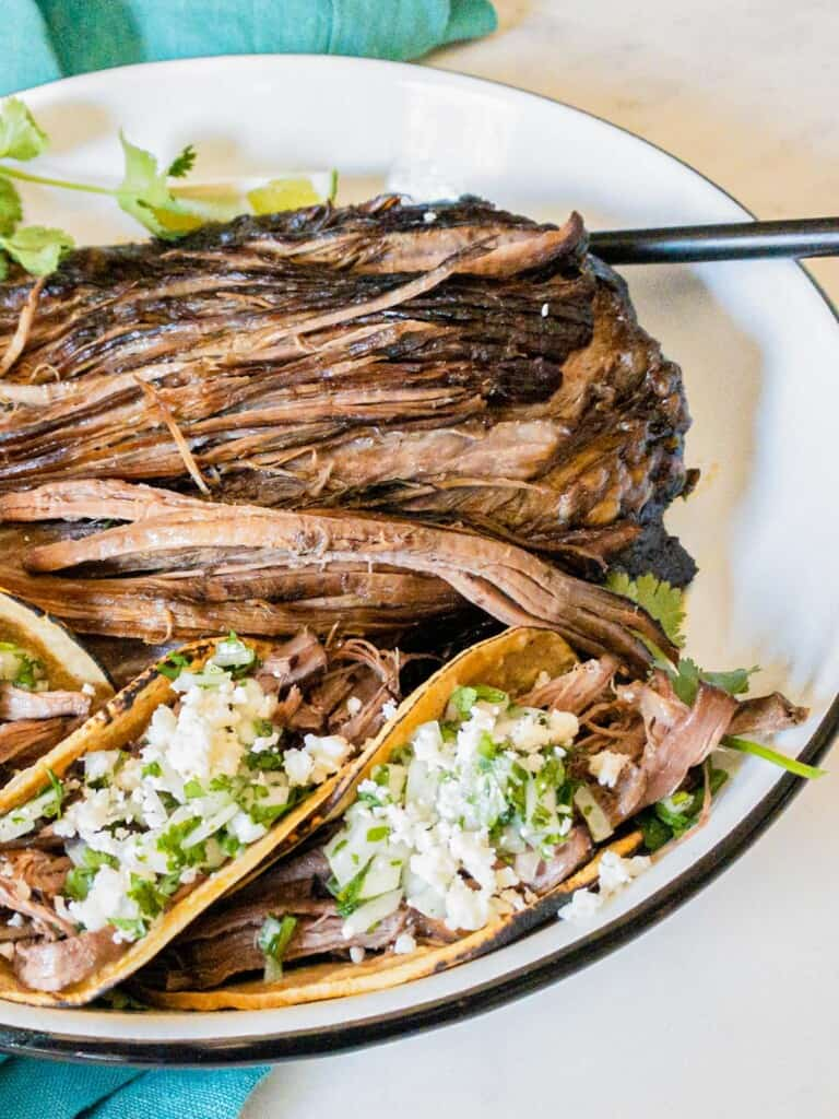 shredded beef tacos in a dish
