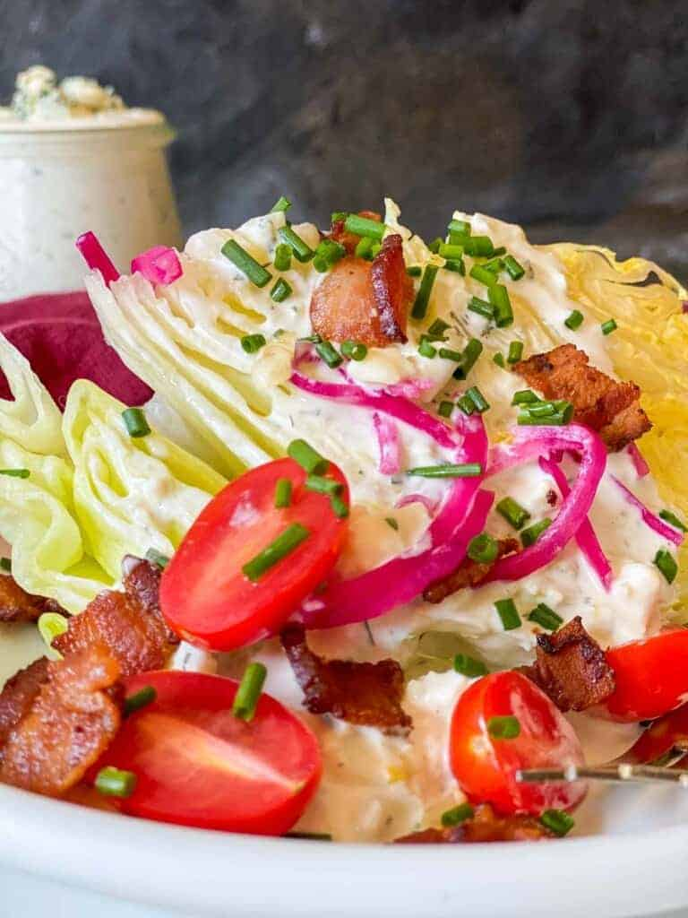 classic blue cheese wedge salad with all the toppings and homemade blue cheese dressing