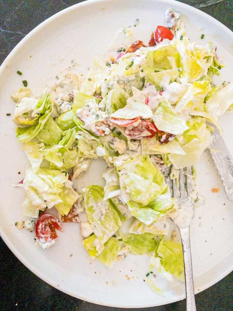 slice the wedge salad up into pieces and toss all the topping together.