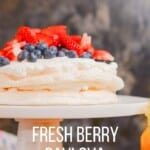 Classic Pavlova Recipe | Pavlova is made of a crispy but chewy on the inside meringue. This pavlova recipe is layered with lemon curd, whipped cream, and fresh berries.