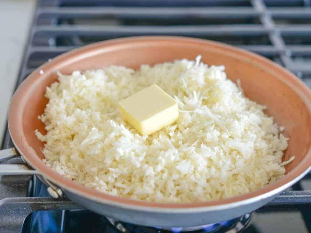 add cauliflower and butter to a sauté pan