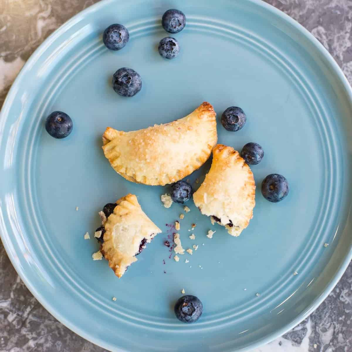 two blueberry hand pies with homemade blueberry filling