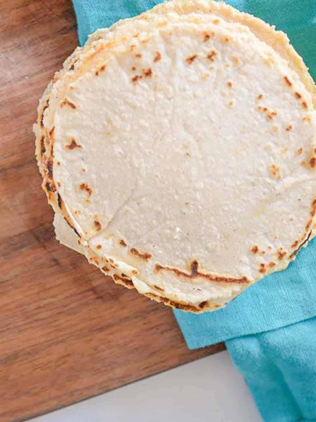 a stack of homemade corn tortillas