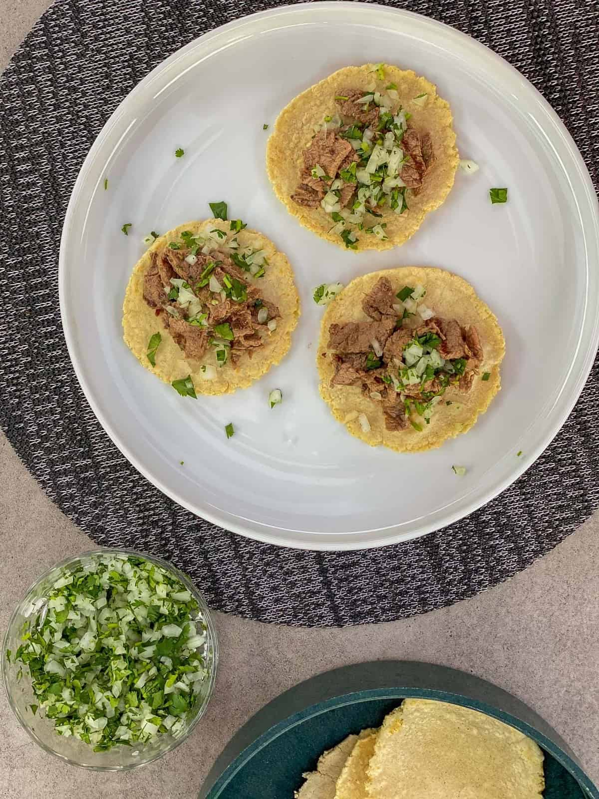 grilled carne asada on homemade corn tortillas with pico de gallo