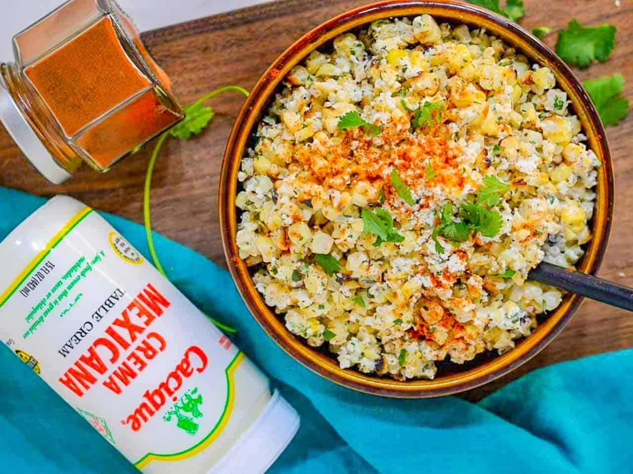 Mexican Corn Salad is a charred, buttered corn salad with a creamy dressing. AKA as Esquites - spicy, cheesy corn in a cup snack.
