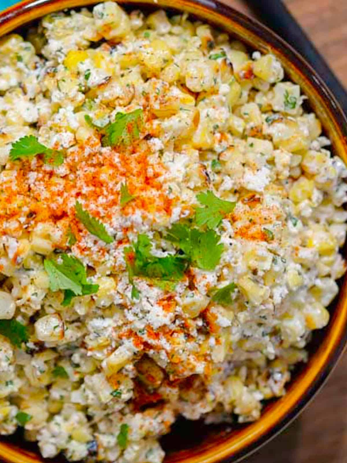 esquites (mexican corn salad) with creamy, spicy dressing