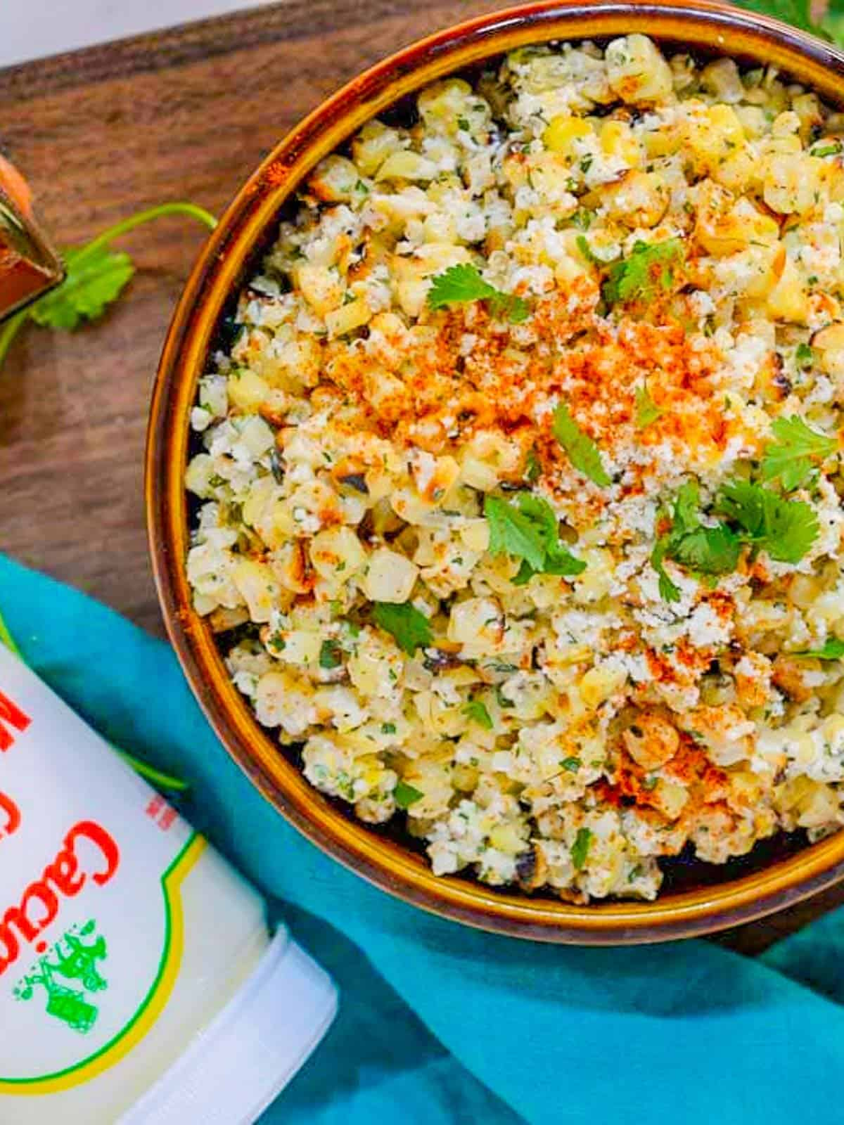 Mexican street corn salad recipe with crema and a spicy creamy sauce