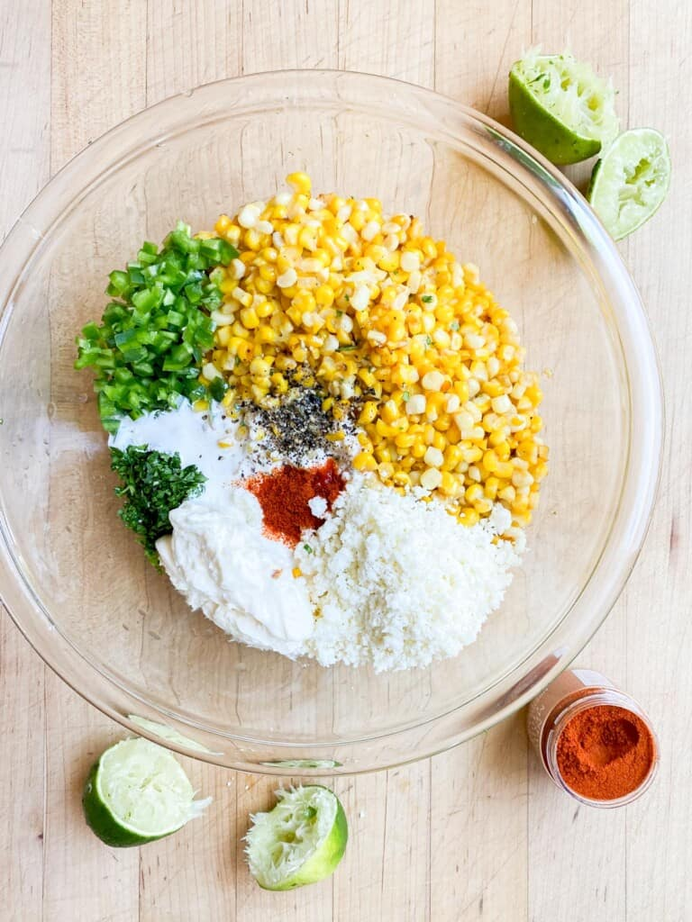 making the mexican corn salad, all the ingredients in a bowl.