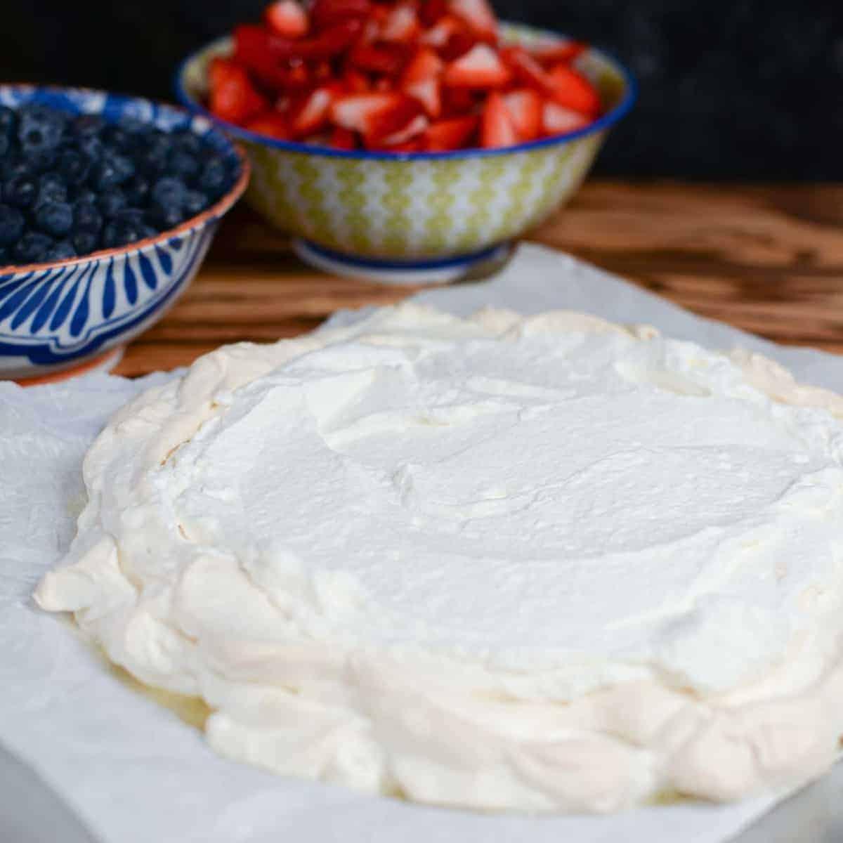 pavlova layered with whipped cream