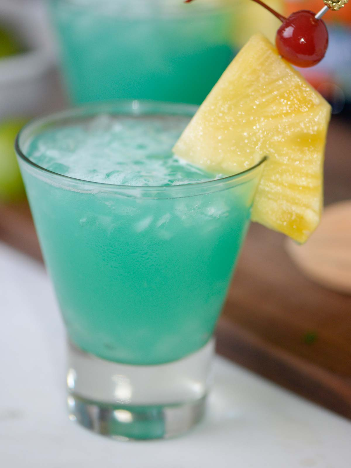 blue hawaii cocktail with pineapple and a cherry
