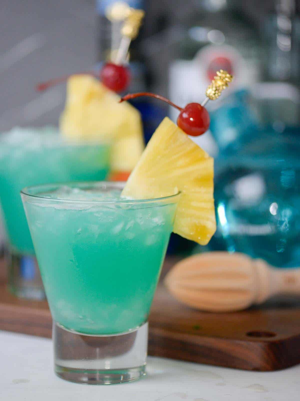 blue hawaii cocktails with pineapple and cherries