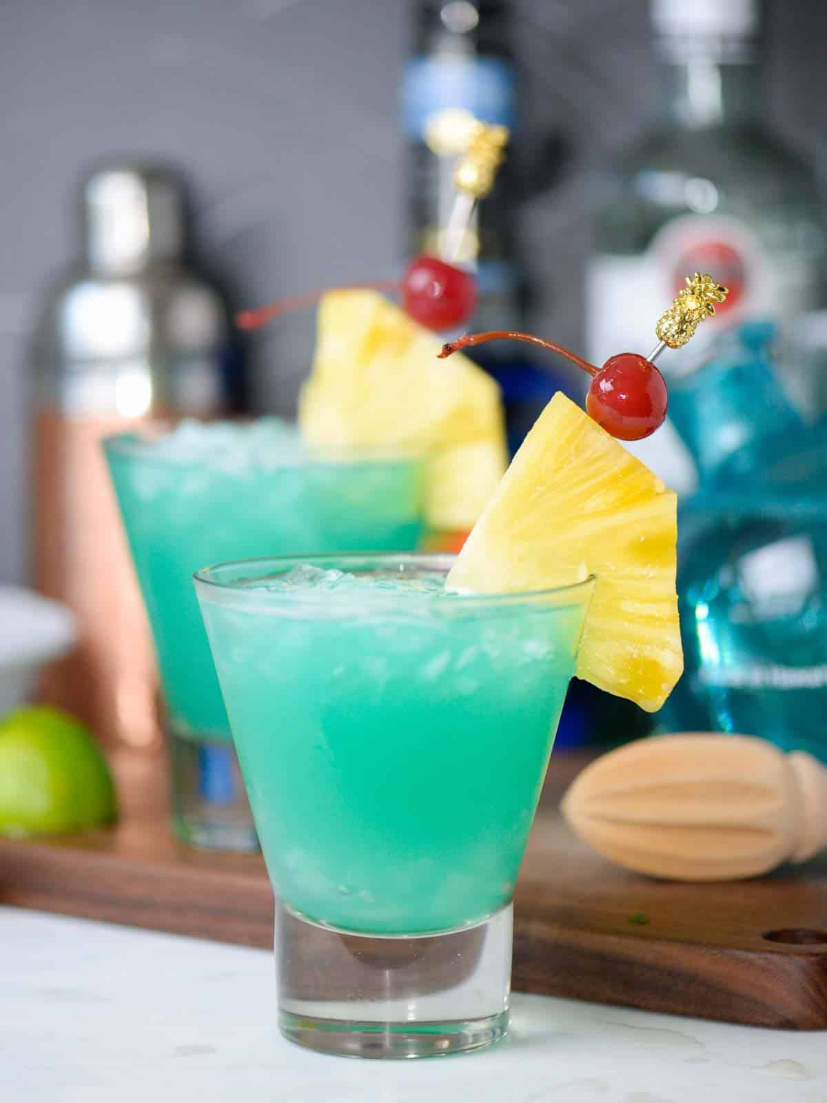 tropical cocktail recipes the blue hawaii, 2 drinks served over crushed ice