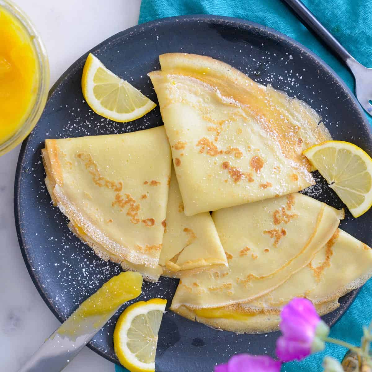 3 french crepes with lemon curd and powdered sugar