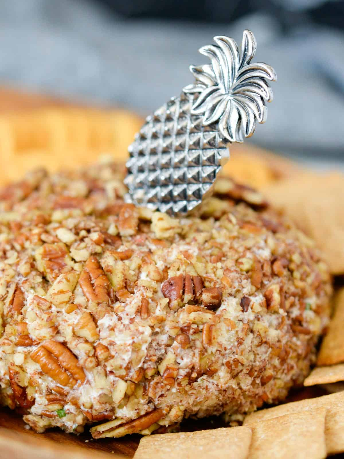 The original kraft pineapple cheeseball covered in pecans, served with ritz crackers