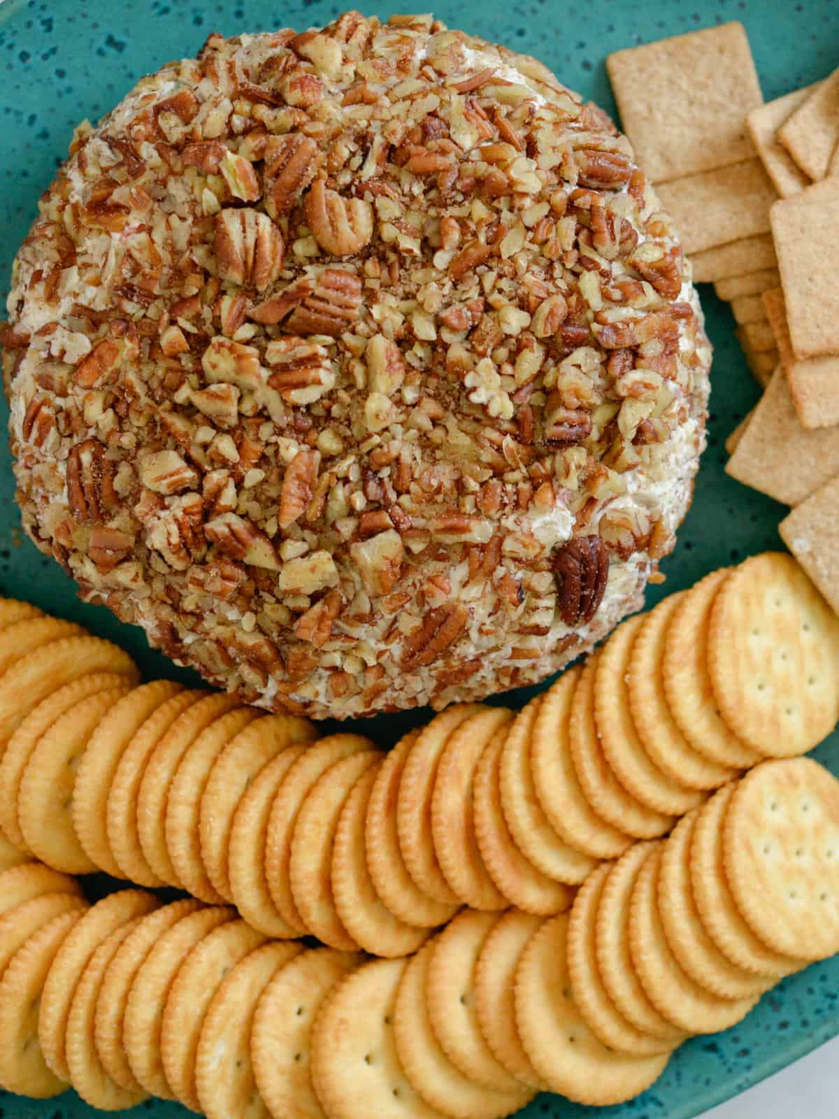 pineapple pecan cheese ball with ritz crackers and wheat thins