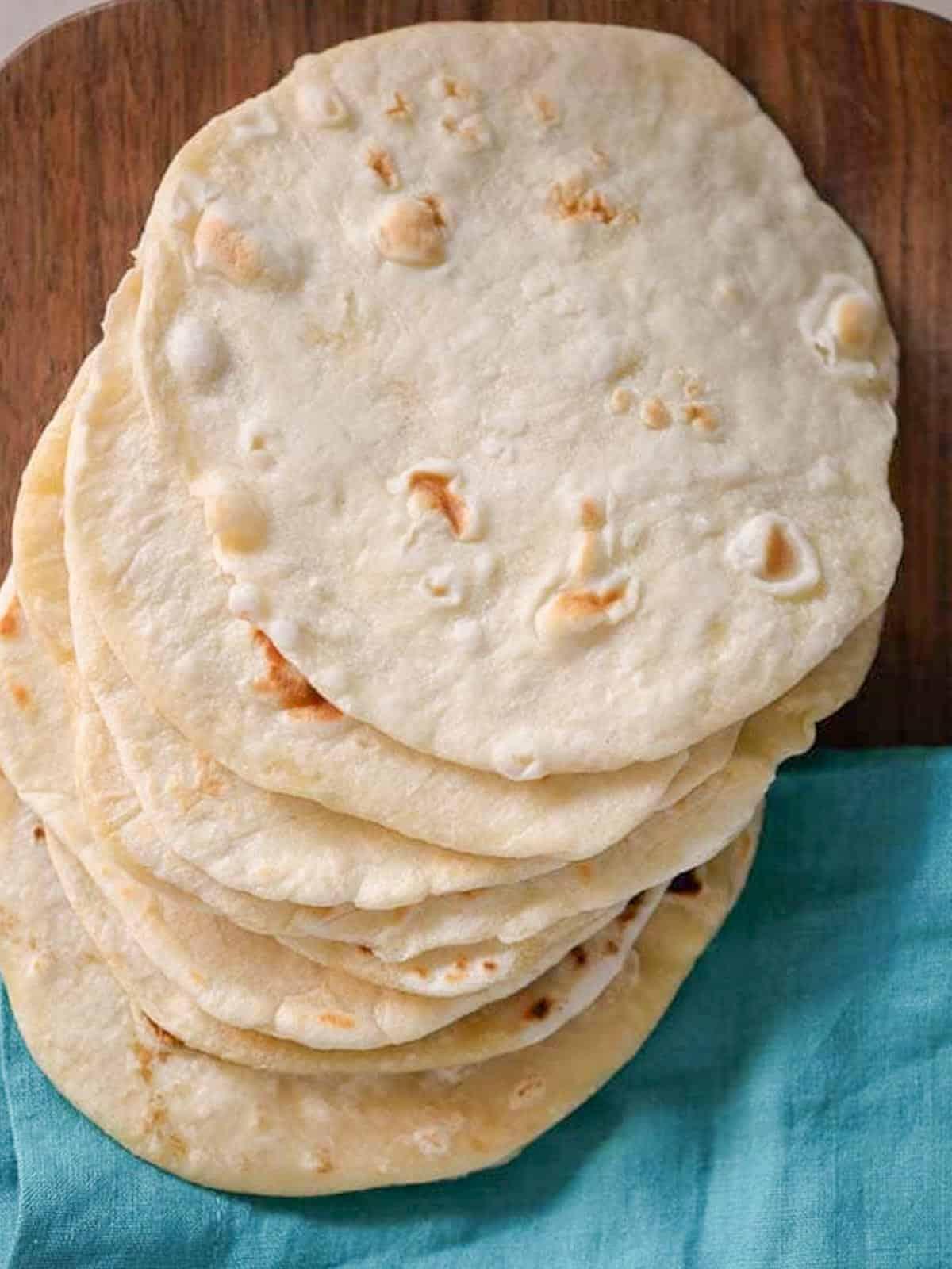 easy homemade flour tortillas on a cutting board