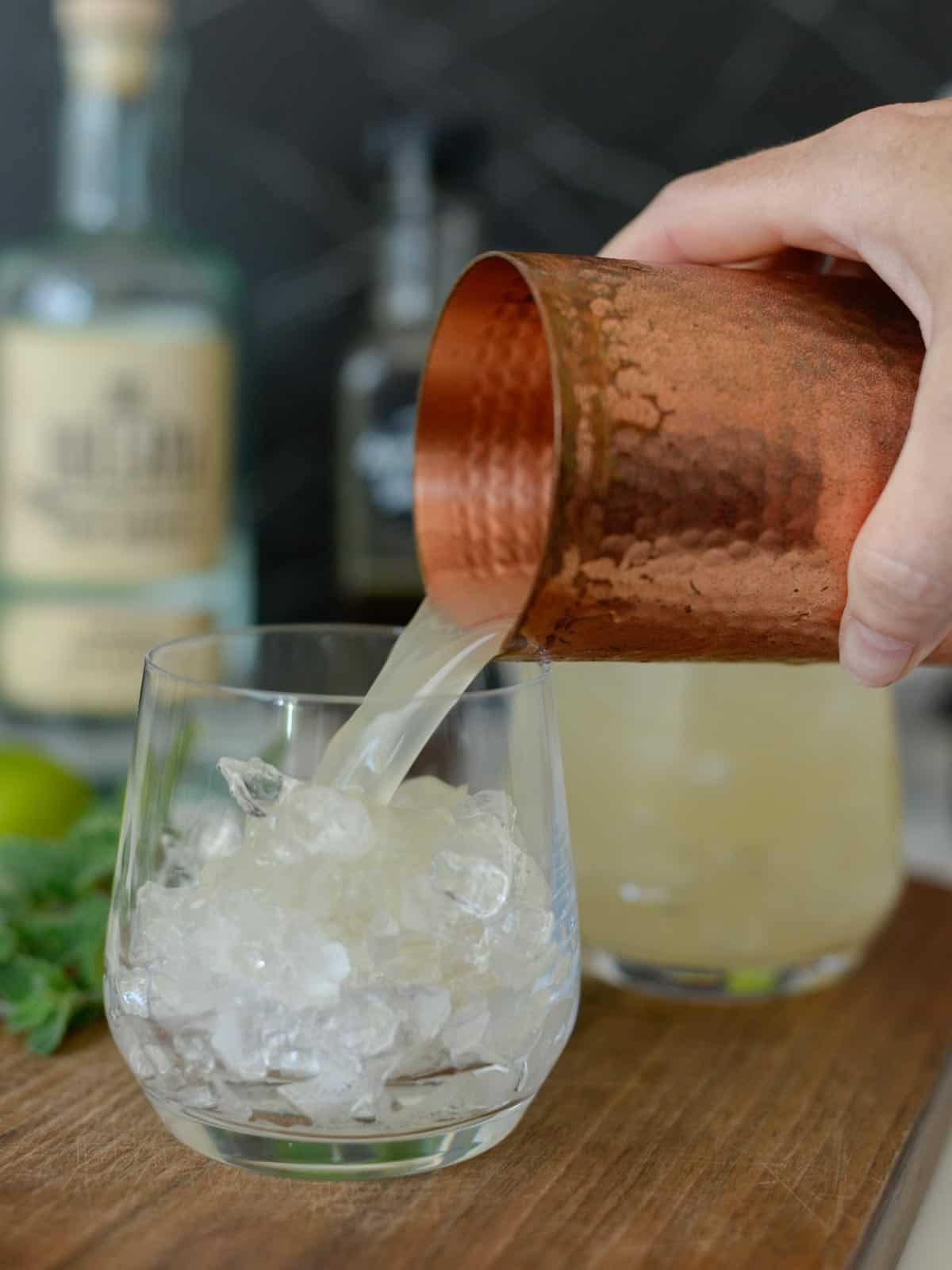 Mai Tai Recipe being poured over ice in an double old fashioned glass