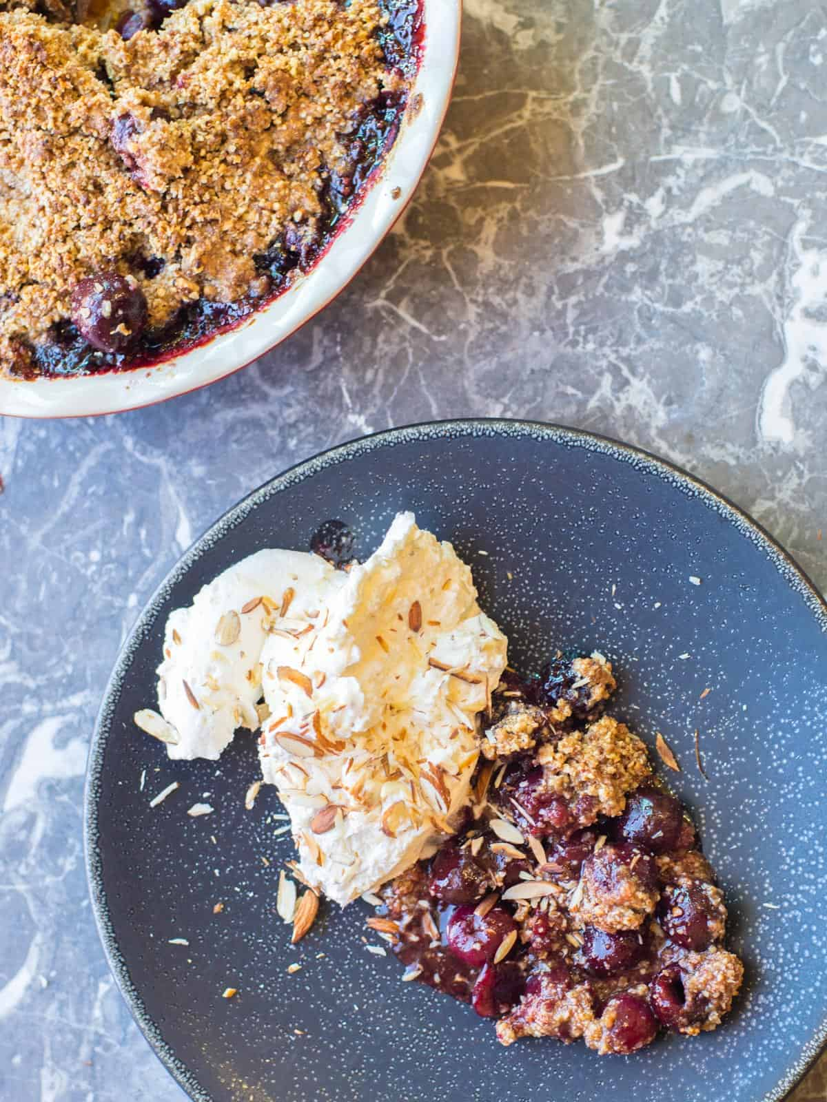 cherry crumble made with fresh cherries and a gluten free almond crumble topping