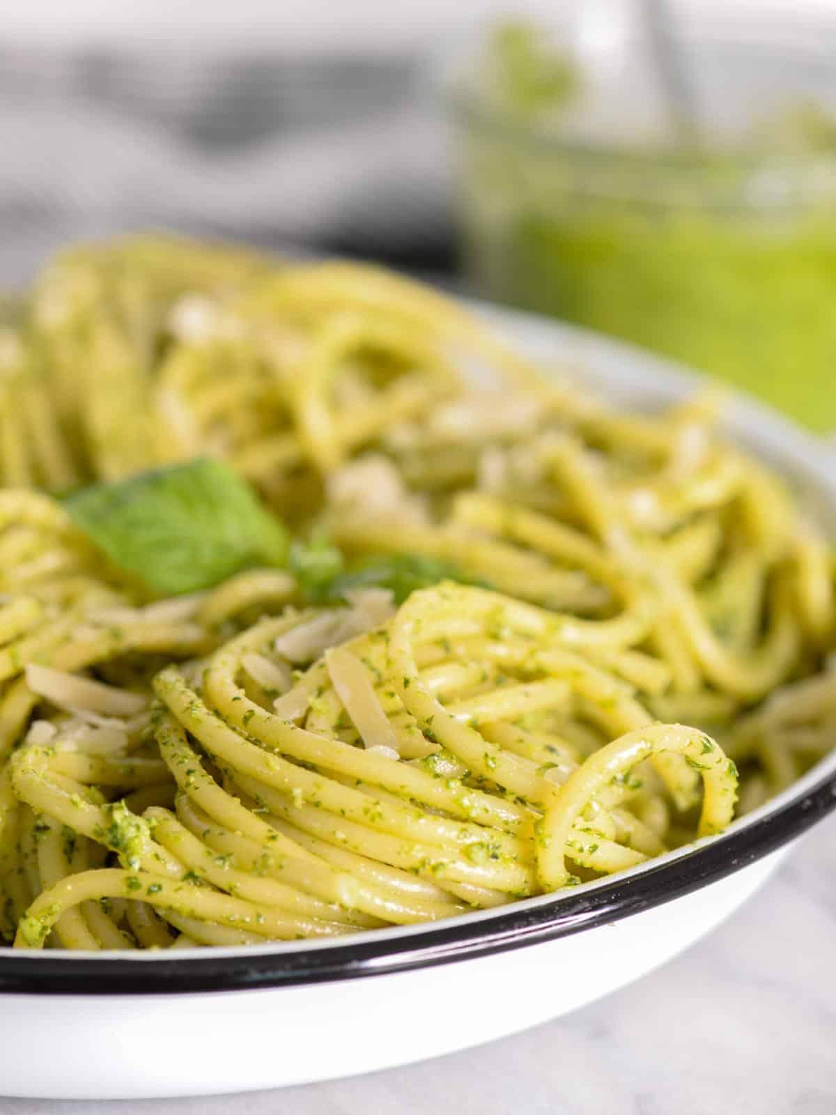 a bowl of pasta with homemade pesto sauce