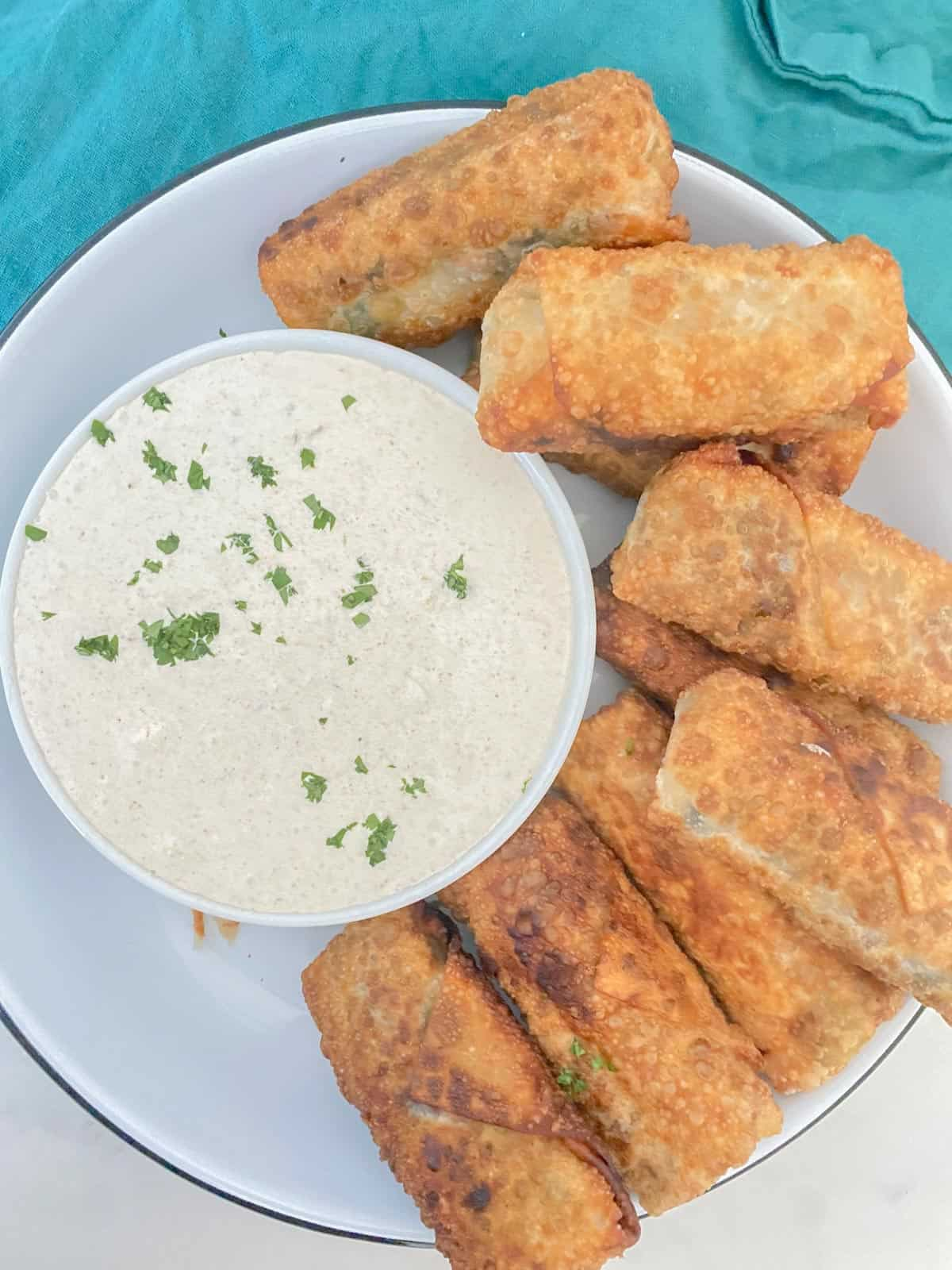 vegetarian egg rolls with a spicy dipping sauce