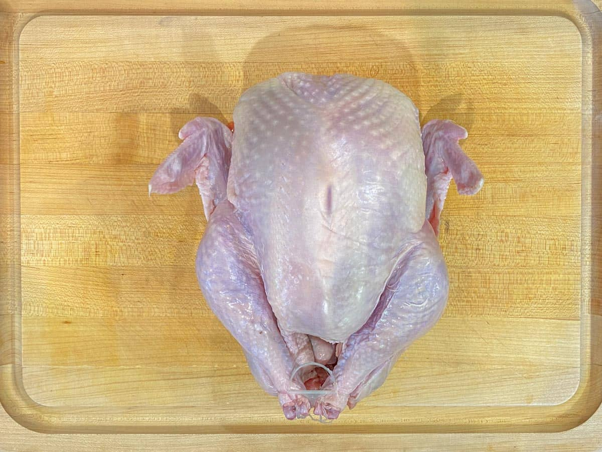 prepping the turkey to spatchcock